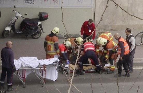 3272e4d300000578-3504028-rescue_effort_a_maelbeek_victim_is_carried_on_to_a_stretcher_as_-a-41_1458639895538