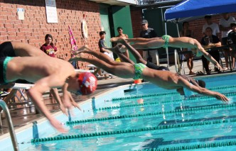 Kennedy swimmers get the edge and dive in before their competition. (Photo by Dominic Larsen)