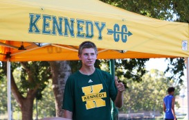 Luke Adel (Junior) posing in front of the Kennedy Cross Country tent. Photo by Alex Ng