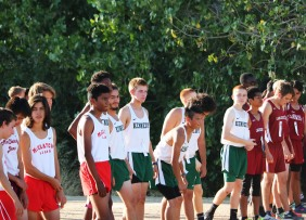 Varsity Boys prime themselves at the starting line. Photo by Alex Ng.