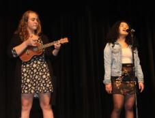 Alexa Mark singing, and Brooke Berry-Vanderpool on ukulele.