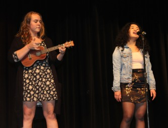 Alexa Mark singing, and Brooke Berry-Vanderpool on ukulele.