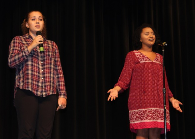 Eve Greenlow and Alejandrea Oliver reciting a love poem.