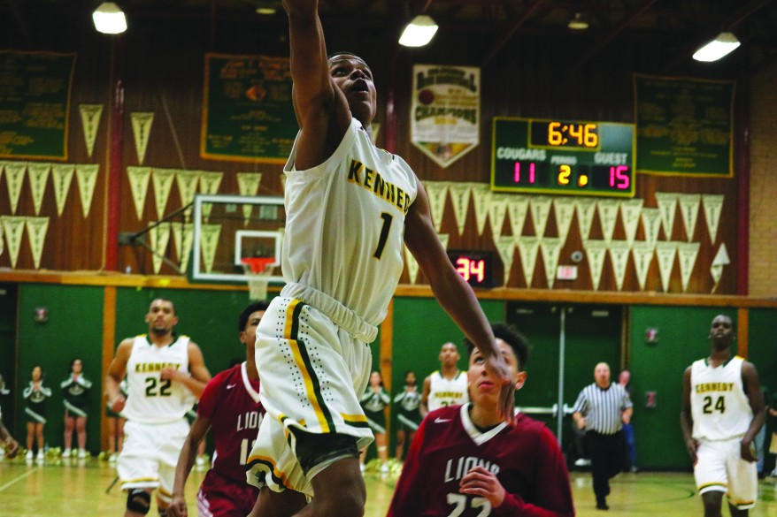 Cougar player Khnemu Riddick scores against rival McClatchy