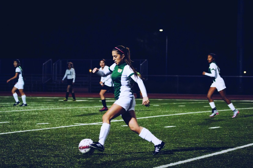 Jennifer Munoz takes the ball and rushes the opponent's goal (photo by Keegan Morris)