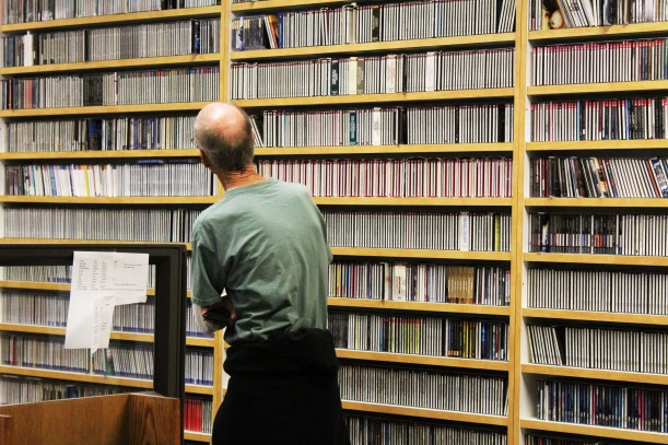 Mr. Hanzlik, advisor for The Kennedy Clarion, admiring CPR's extensive music CD collection.
