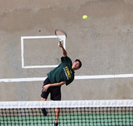 Kennedy senior, Elliott Tom shown in singles match against Christian Brothers on March 7. Photo by Alex Ng