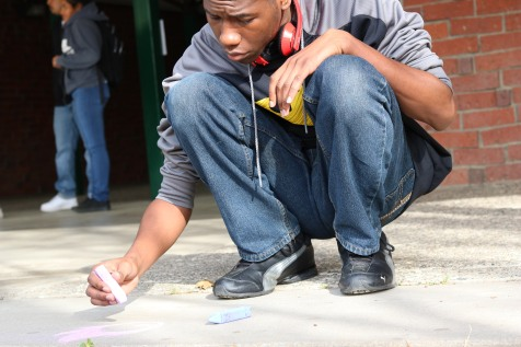 Kennedy student Kevin Smith shown participating on March 20, actively producing live art on campus during the month-long Student Art Month celebration. (Photo by Alex Ng)
