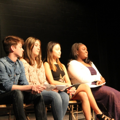 Speeches in hand, the ASB cabinet candidates, from left to right, ASB secretary candidate Jake Estigoy (10), ASB treasurer candidate Lauryl Gonzalez (10), ASB Vice Presidential Candidate Julia Cheng (11), and ASB Presidential Candidate Makenzie Cross (11) anxiously await their turns to speak. The four ran unopposed, but still were required to give speeches and achieve student approval. (Photo by Jazmin Flemmer)