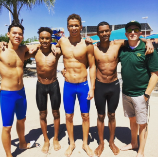 The relay team broke JFK's 30-year old 400 Free style relay record on Saturday, April 29. Left to Right: Co-Captain Matt Lee (Soph), Jordan Selvin (Soph), Grant Greenlow (Soph), and Calvin Elliot (Soph), and Coach Perkins. Photo courtesy Dinah Lee