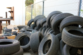 A stack of tires lay in wait as the M.A.D program students tinker away on next generation robotics and donated automobiles. (Photo by Dominic Larsen)