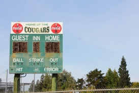 Vintage Coca-Cola advertisements and patina showcase the memories forged on the field by generations of Kennedy sluggers. (Photo by Dominic Larsen)