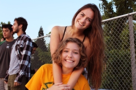 Savannah Perry and Hannah Dieckman (12) embrace each other's company. The two were treated to banana bread muffins baked by Clarion staff Dominic Larsen prior to the photo. (Photo by Bruce Tran)