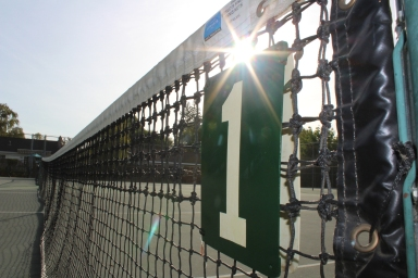 """When I was walking towards the tennis courts, the """"1"""" on the first court called my attention. The sign is a reminder that win or lose, we are always number one. (Photo by Miya Murata)"""