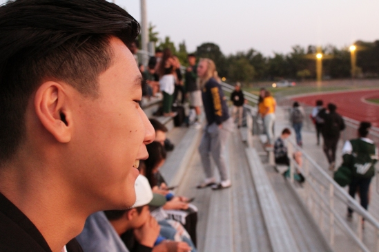 Enjoying the sunrise, Nelson Poon (12) spends time with his friends. Seniors gathered to watch the sun rise over their final year in high school on the morning of September 8, 2017. (Photo by Bruce Tran)