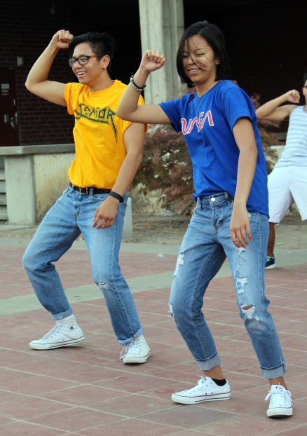 Dominick Lee, senior, and sister Kyla Lee, junior, take the lead after the entire group takes it from the top to show their newly learned dance moves.