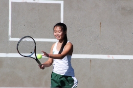 Sarah Wong  (12) practices her serves before her match. The serve is one of the most important moments in a tennis game. (Photo by Bruce Tran)