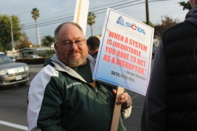 JFK English teacher Joe Spatafore wields a sign provided by the SCTA. Current superintendent Jorge Aguilar made that statement in a recent article published in the Fresno Bee. (Photo by Chris Wong)