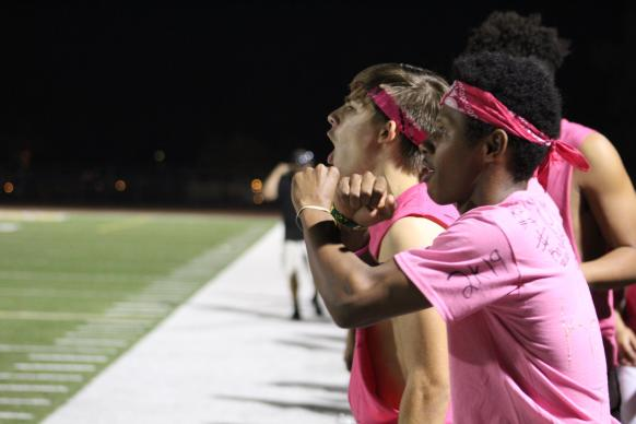 Male cheerleaders in pink at Powderpuff Game captured by Clarion photographer Makayla Smith