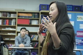 Energy flowing into her hands, Mai Vang emotionally explains her history before becoming a district board member exactly one year before visiting Kennedy on December, 8, 2017. Mr. Williams called in several government officials to help connect students to politicians for their Civic Action Projects. (Photo by Bruce Tran)