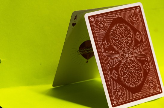 "25-CARD by Sarif Morningstar. ""These are my theory11 cards. I really like the crimson red so I decide to contrast it with a green background. The colors were complementary and make the card really stand out."""