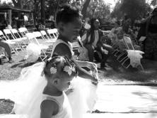 """27-CELEBRATION by Makayla Smith """"Two flower girls walking during the wedding ceremony held at William Land Park, throwing flower pedals down the aisle."""