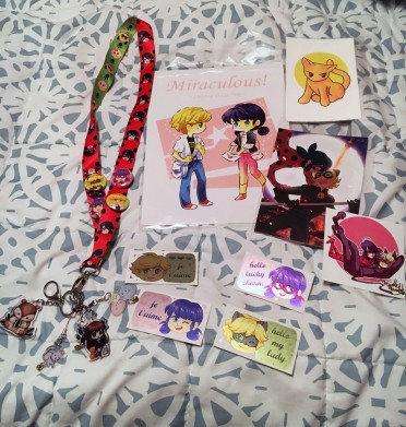 "6-OBSESSION-Desiree Leong. ""6-All of my fanart merchandise that I bought from SacAnime, mostly from the show, Miraculous Ladybug."""