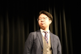 Calmly staring into the crowd, Ryan Cai (12) humbly accepts his applause. Cai joined choir as a piano accompanist only weeks before the concert. (Photo by Sarif Morningstar)