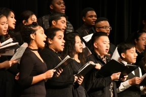 Projecting their voices out to the crowd, the Kennedy choir soprano and bass sections spread holiday cheer through song. Choir director Mr. Bryan Stroh conducts the choir every concert. (Photo by Sarif Morningstar)