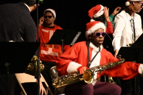 Sporting purple Sacramento Kings sunglasses, Ellis Penn (11), sets up before the jazz band performance. The Sacramento Kings gave Mr. Hammond the sunglasses after the event with Vince Carter. (Photo by Sarif Morningstar)