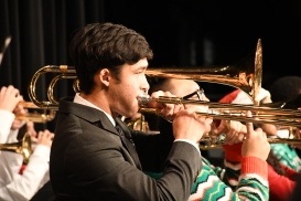 "Reading his music, Harrison Arakawa (11) performs ""A Big Band Christmas"" on trombone. (Photo by Sarif Morningstar)"