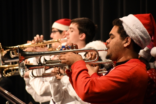 Playing in unison with the other trumpets, Armando Muse (9) performs his first winter concert with the Kennedy band. (Photo by Sarif Morningstar)