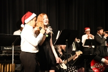 Nate Davis (Left, 10) and Haley Flanagan (Right, 11) duet to the classic song, Baby It's Cold Outside. Vocals are rare in Kennedy jazz band concerts. (Photo by Sarif Morningstar)
