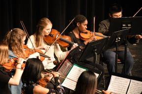 Though smaller than last year, the Kennedy orchestra still output a great performance. The orchestra is composed of mostly underclassmen. (Photo by Sarif Morningstar)
