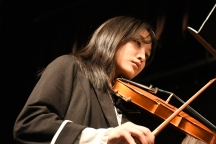 Gently bowing her violin, Annabell Vue (10) plays at the winter concert. (Photo by Sarif Morningstar)