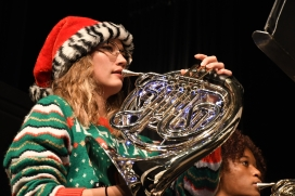 Lights strung on her french horn, french horn/mellophone section leader Kaylee Kazee (11) takes a breath to prepare for the next phrase. Kazee got the lights from a separate band, Sacramento Youth Band during its trip to Santa Cruz to play in a night parade. (Photo by Sarif Morningstar)
