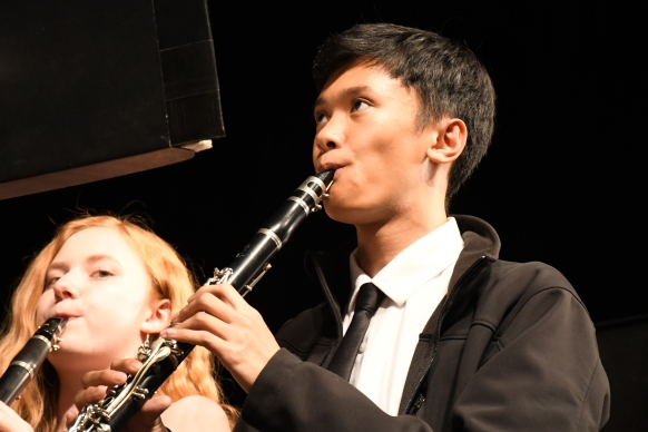 Watching band director Mr. Jeremy Hammond's baton for tempo, clarinetist Joseph Samosa (12) plays holiday music for concert band. This was Samosa's fourth year in the Kennedy band, so much of the holiday music was familiar to him. (Photo by Sarif Morningstar)