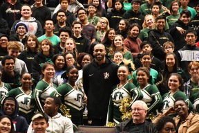 Kennedy students gather around Vince Carter for a posed publicity shot. (Photo by Sarif Morningstar)