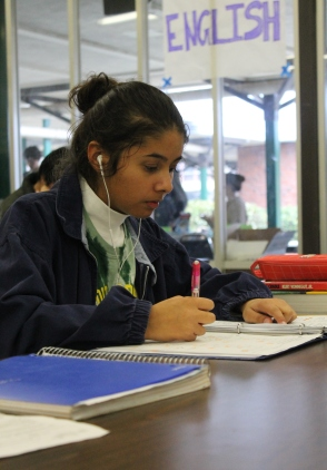 After finishing her cocoa, senior and Link Crew leader Sarah Cerda goes over her english notes while listening to music.
