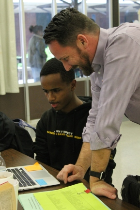 Studying for multiple subjects, freshman Isaac Petros gets help from Kristopher McCarthy for an english assignment.