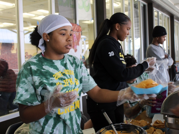 While selling nachos and hot dogs at Cocoa and Cram, senior and Link Crew Leader Malissia Bordeaux serves the food.