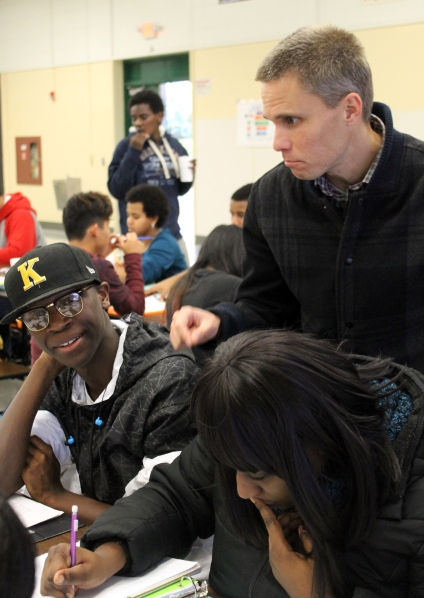 AP Government teacher Brett Williams goes over his final requirements with seniors Imani Houston and Jacob Jones.