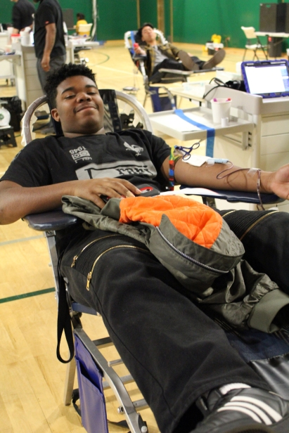 Relaxed for the 30 minute donation process, Jordan Davis (12) enjoys being a part of something bigger than himself.