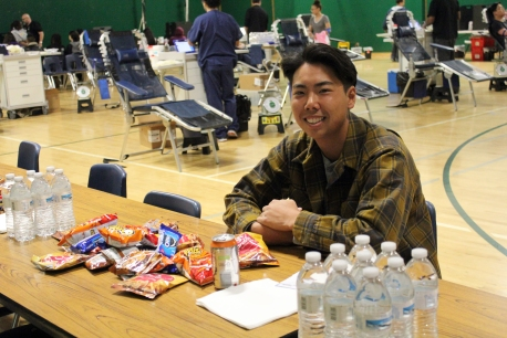 Having finished donating blood, Blake Yuyama (11) replenishes himself with the free food and drinks provided.