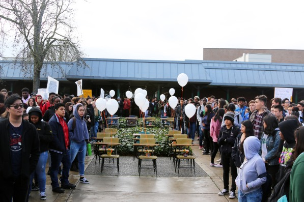 Kennedy students gather around the 17 empty chairs during the 17-minute student walkout. (Clarion staff photo)