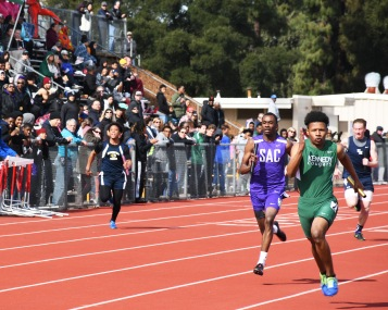 Cummings (12) keeps ahead of Sacramento High opponent in the sprint relay at Clarke Massey Relays, Feb 24. Clarion photo by Sarif Morningstar
