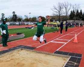 Sam Hewell (10) flies through varsity triple jump event during the JFK Spring home opening track & field meet, Feb. 28. Photo by Sarif Morningstar