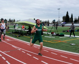 Varsity Long Distance runner Billy T Hernandez hustles through the finish line after tiring 1 mile event. Photo by Sarif Morningstar