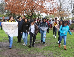 Kennedy students leave the front of the JFK on a walk around the campus during Walkout event. (Clarion staff photo)