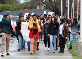 Kennedy students walk along the west side of the campus between parking lot and auditorium during Walkout event. (Clarion staff photo)
